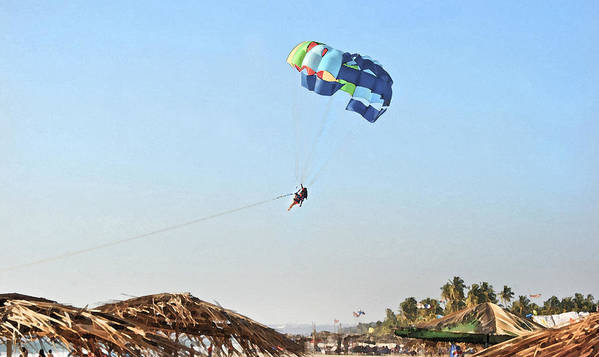Vibrant Poster featuring the photograph Couple Parasailing Over Shacks Goa by Kantilal Patel