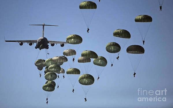Parachutist Poster featuring the photograph U.s. Army Paratroopers Jumping by Stocktrek Images