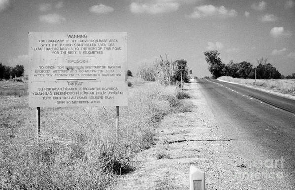 Sba Poster featuring the photograph warning road sign warning of the border of the turkish military controlled area of the SBA Sovereign by Joe Fox