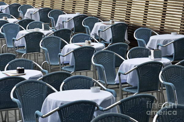 Blue Poster featuring the photograph Empty Restaurant Seats And Tables by Sami Sarkis