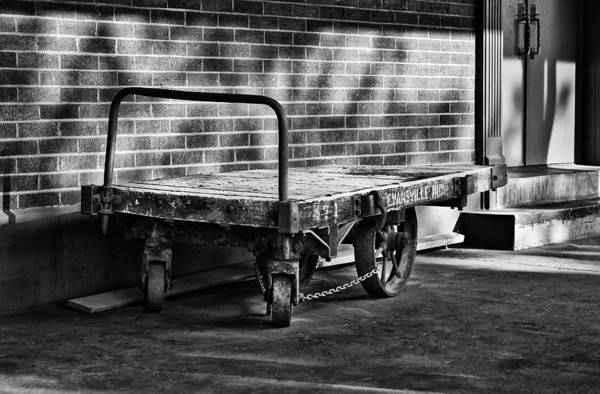 Train Depot Baggage Cart In B/w Poster featuring the photograph Train Depot Baggage Cart In B/w by Greg Jackson