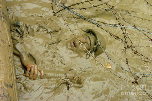 Horizontal Poster featuring the photograph A Seabee Emerges From Muddy Water by Stocktrek Images