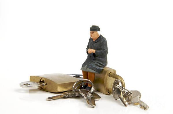 Ups Poster featuring the photograph Miniature Figurines Of Elderly Sitting On Padlocks by Bernard Jaubert