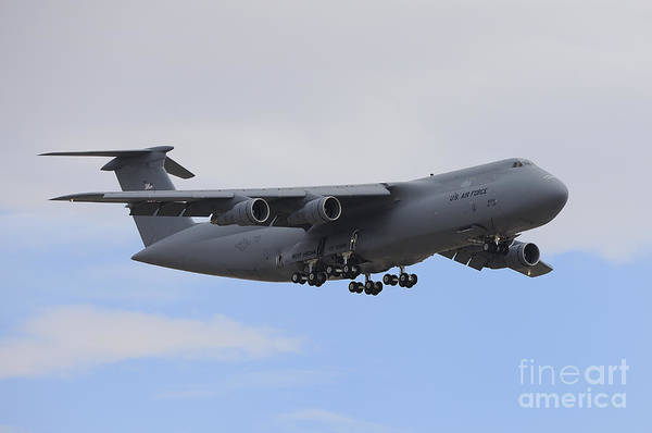 Horizontal Poster featuring the photograph A C-5 Galaxy In Flight Over Nevada by Remo Guidi