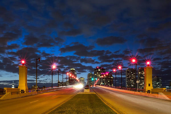 Clouds Poster featuring the photograph Night Lights by Debra and Dave Vanderlaan