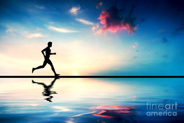 Jogging Poster featuring the photograph Silhouette Of Man Running At Sunset by Michal Bednarek