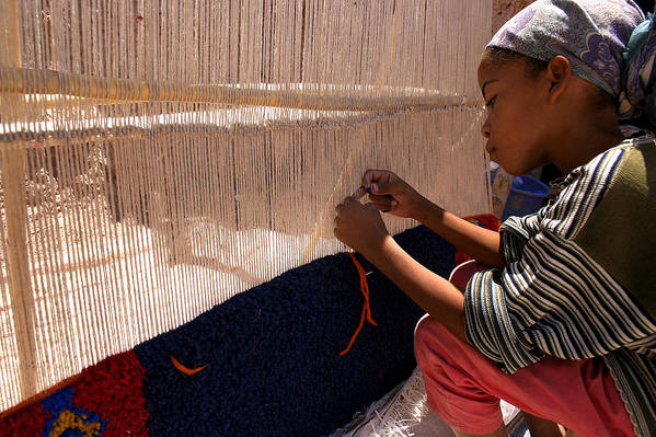 Berber Girl Poster featuring the photograph Berber Girl Working On Traditional Berber Rug Ait Benhaddou Southern Morocco by Ralph A Ledergerber-Photography