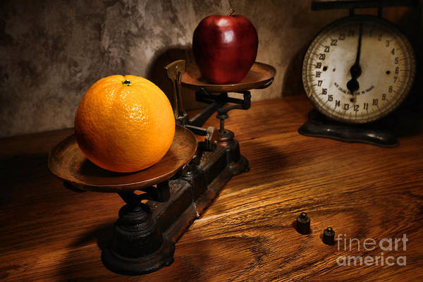 Orange Poster featuring the photograph Comparing Apple And Orange by Olivier Le Queinec