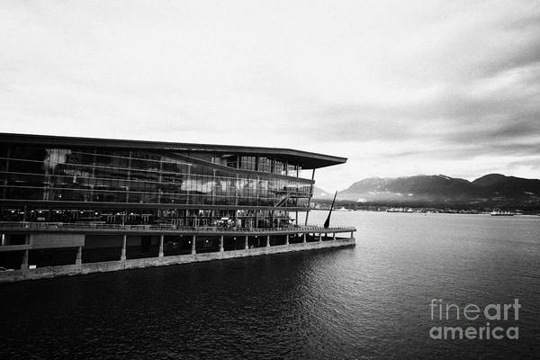 Early Poster featuring the photograph early morning at the Vancouver convention centre west building on burrard inlet BC Canada by Joe Fox