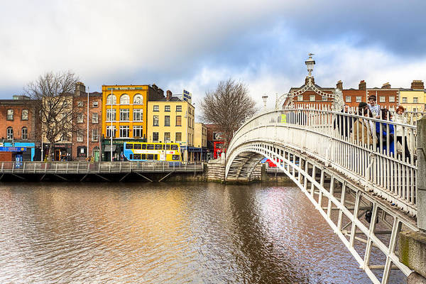 Dublin Poster featuring the photograph Graceful Ha'penny Bridge Over River Liffey by Mark E Tisdale