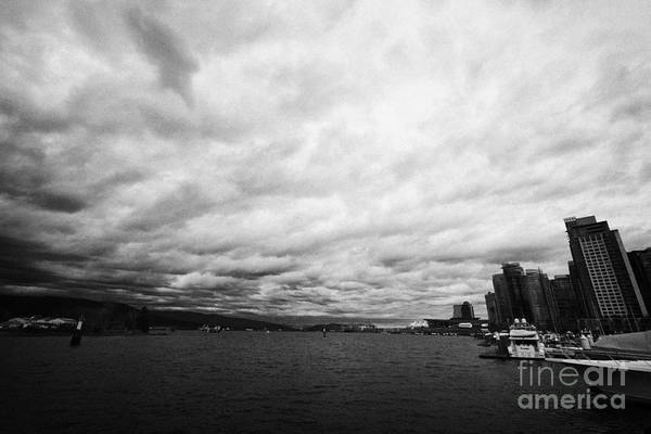 Looking Poster featuring the photograph looking out from coal harbour into Vancouver Harbour on an overcast cloudy day BC Canada by Joe Fox