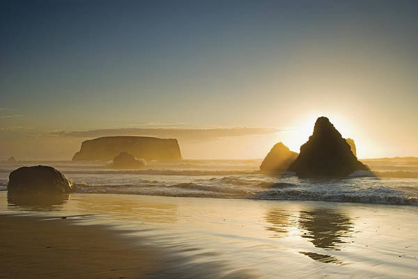 Sunset Poster featuring the photograph Sunset Behind Offshore Rocks Bandon by Philippe Widling