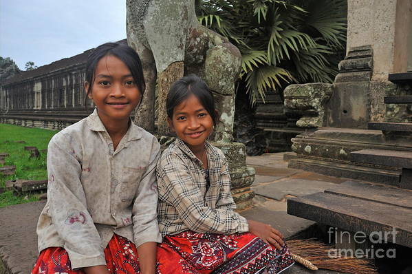 Children Poster featuring the photograph Two Young Cambodian Girls In Angkor Wat by Sami Sarkis