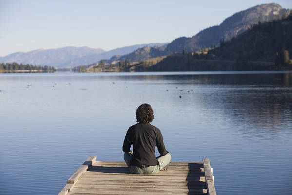 Okanagan Valley Poster featuring the photograph A Woman Enjoys Yoga And Relaxation by Taylor S. Kennedy