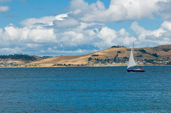 Beige Poster featuring the photograph Luxury Yacht Sails In Blue Waters Along A Summer Coast Line by Ulrich Schade
