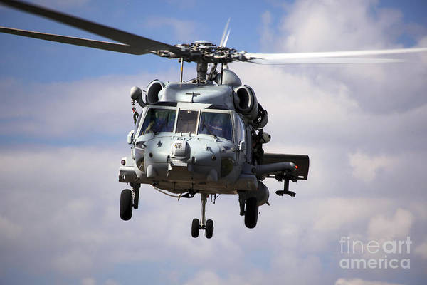 Military Poster featuring the photograph Navy Pilots In A Sh-60f Seahawk Conduct by Michael Wood