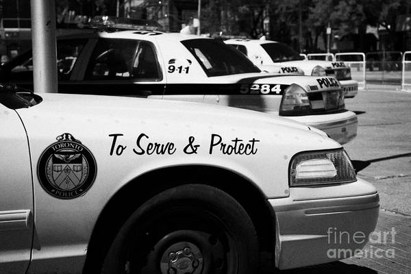 Toronto Poster featuring the photograph Toronto Police Squad Cars Outside Police Station In Downtown Toronto Ontario Canada by Joe Fox