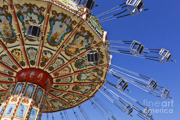 Blue Sky Poster featuring the photograph Swing Ride At The Fair by Jeremy Woodhouse
