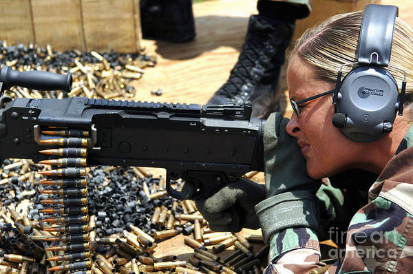 Color Image Poster featuring the photograph A Soldier Fires An M240b Medium Machine by Stocktrek Images