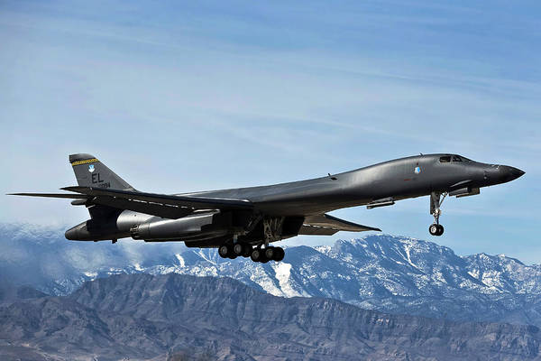 Nellis Air Force Base Poster featuring the photograph A U.s. Air Force B-1b Lancer Departs by Stocktrek Images