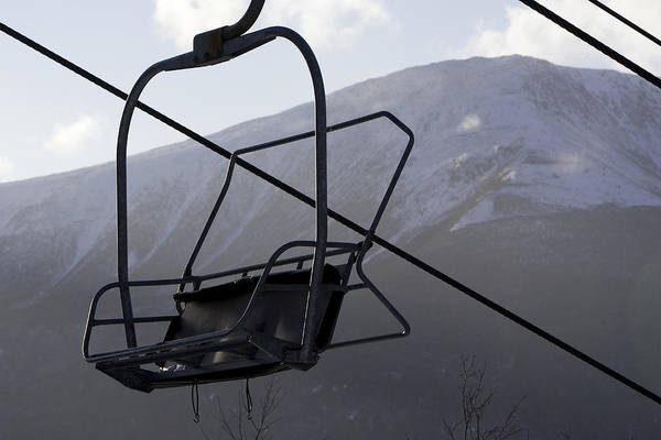 Ski Lifts Poster featuring the photograph An Empty Chair Lift At A Ski Resort by Tim Laman