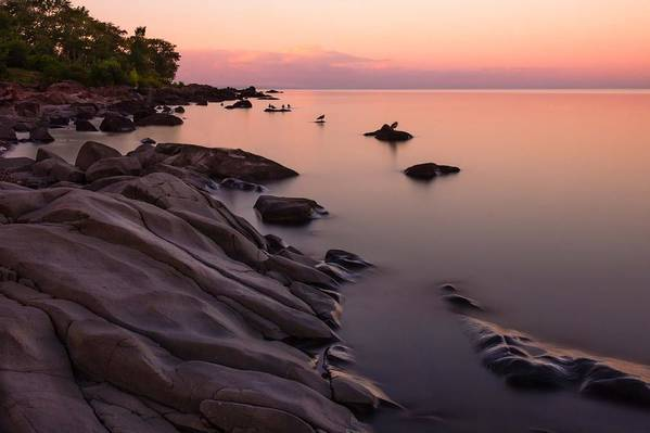 dimming Of The Day a Wonderful Song By Bonnie Raitt sunset Calm Peace Serenity lake Superior lake Superior Sunset brighton Beach Duluth Minnesota Nature long Exposure lake Superior Northshore ancient Rocks magic Poster featuring the photograph Dimming Of The Day by Mary Amerman