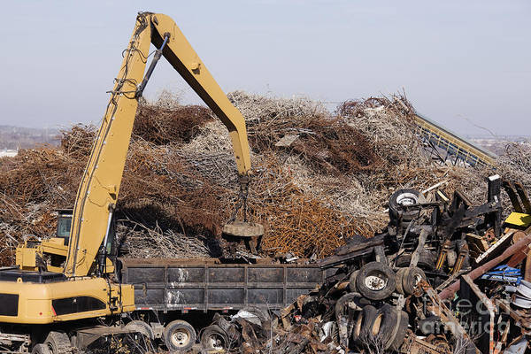 Blue Collar Poster featuring the photograph Excavator Moving Scrap Metal With Electro Magnet by Jeremy Woodhouse