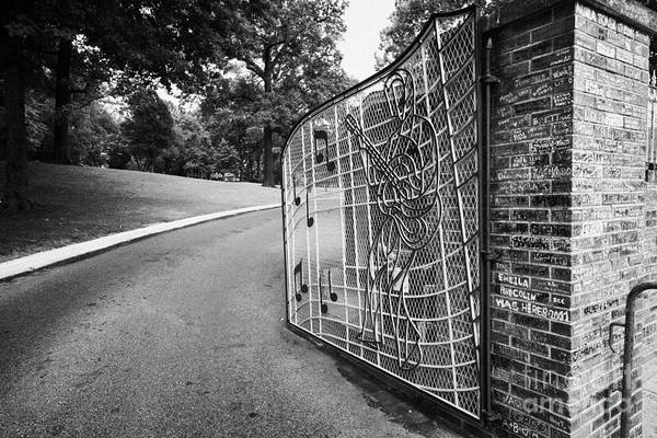 Elvis Poster featuring the photograph Gate And Driveway Of Graceland Elvis Presleys Mansion Home In Memphis Tennessee Usa by Joe Fox