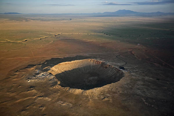 Outdoors Poster featuring the photograph Meteor Crater Is The Best Preserved by Stephen Alvarez