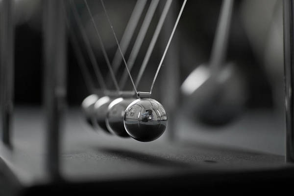 Horizontal Poster featuring the photograph Newton's Cradle In Motion - Metallic Balls by N.J. Simrick