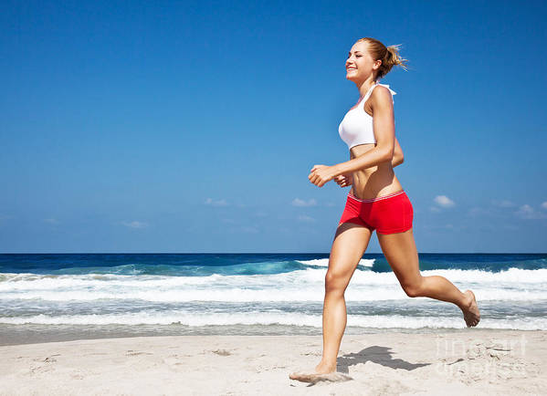 Action Poster featuring the photograph Healthy Woman Running On The Beach by Anna Om