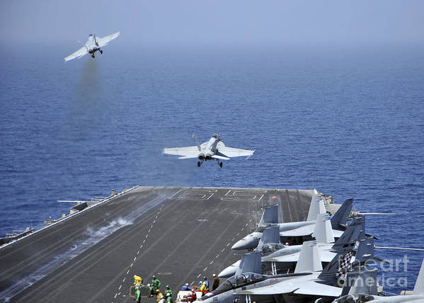 Uss Enterprise Poster featuring the photograph Fa-18f Super Hornets Launch by Stocktrek Images