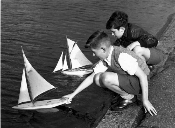 Child Poster featuring the photograph Toy Boats by Harry Todd
