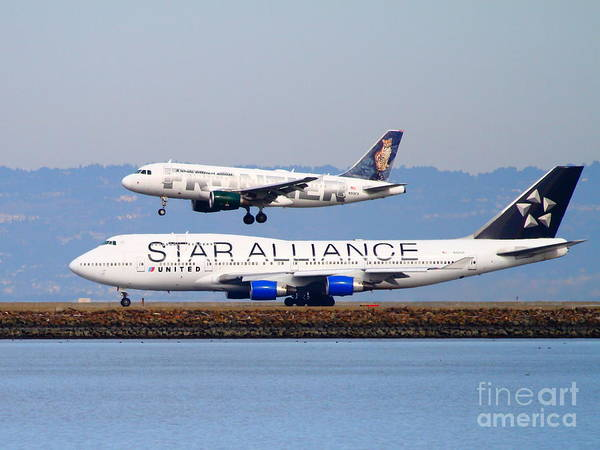 Airplane Poster featuring the photograph Star Alliance Airlines And Frontier Airlines Jet Airplanes At San Francisco International Airport by Wingsdomain Art and Photography