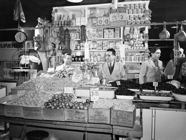 1940s Poster featuring the photograph New York - Italian Grocer In The First by Everett