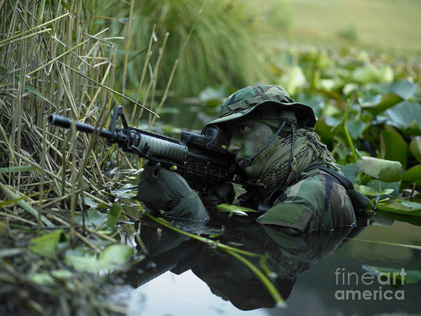 Special Operations Forces Poster featuring the photograph U.s. Navy Seal Crosses Through A Stream by Tom Weber