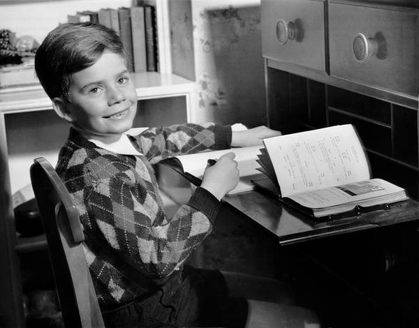 Child Poster featuring the photograph Boy Indoor At Desk by George Marks