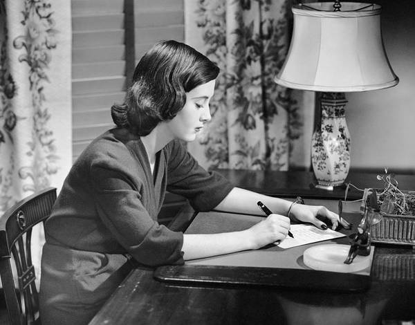 Human Age Poster featuring the photograph Portrait Of Woman Writing Letter At Desk by George Marks