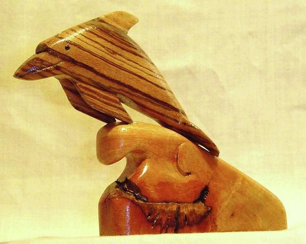 Wood Carving Poster featuring the sculpture Zebrab Wood Dolphin by Russell Ellingsworth
