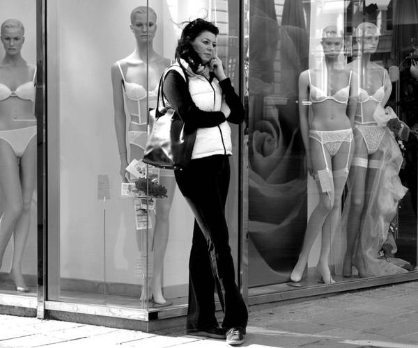 Street Photography Poster featuring the photograph Woman And Mannequins by Todd Fox