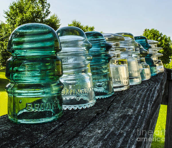 Glass Insulator Poster featuring the photograph Pretty Glass Insulators All In A Row by Deborah Smolinske