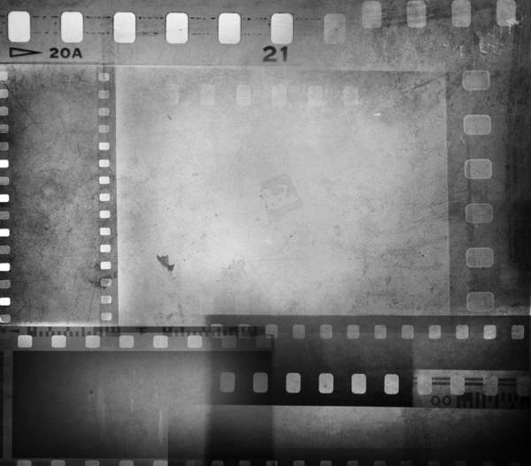 Grey Poster featuring the photograph Film Negatives by Les Cunliffe