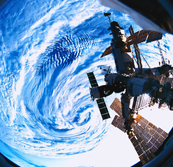 Square Poster featuring the photograph A Space Station Orbiting Above Earth by Stockbyte