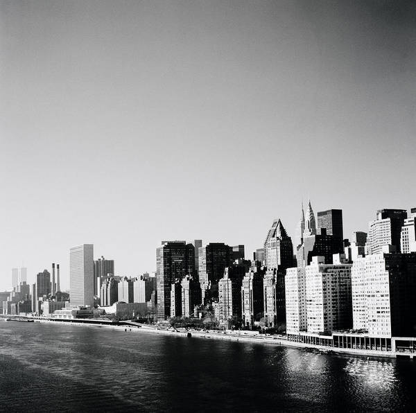 New York Poster featuring the photograph East River New York by Shaun Higson