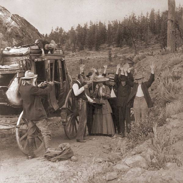 History Poster featuring the photograph Reenactment Of A Stage Coach Robbery by Everett