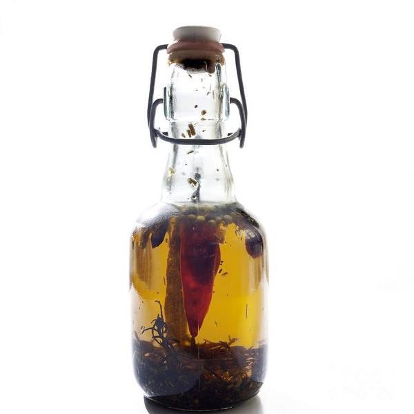 Bottle Poster featuring the photograph Bottle Of Oil by Bernard Jaubert
