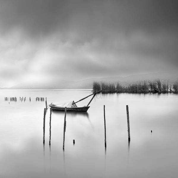 Seascape Poster featuring the photograph Lake View With Poles And Boat by George Digalakis