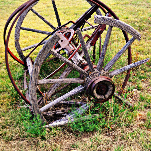 An Old Piece Of Farm Equipment Is Slowly Returning To Nature In The Ozarks Of Missouri. Poster featuring the photograph Thrasher Past by Marty Koch