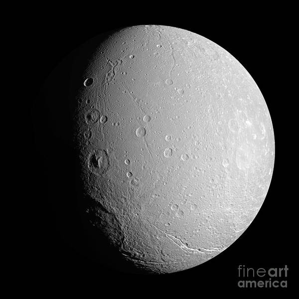 Basin Poster featuring the photograph Saturns Moon Dione by Stocktrek Images