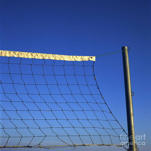 Net Poster featuring the photograph Close-up Of A Volleyball Net Abandoned. by Bernard Jaubert